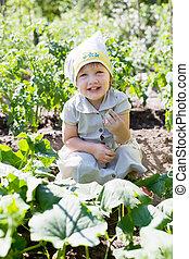 girl in cucumbers plant