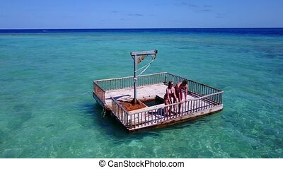 2 young people couple romantic sunbathing on pontoon with...