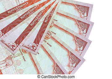 20 Nepalese rupees bills lies isolated on white background with copy space stacked in fan shape close up. Financial transactions concept