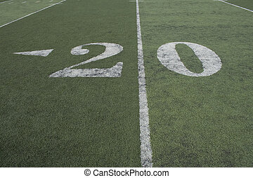 20 yard line of a football field where all the action...