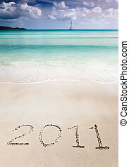 2011 write in the sand of a tropical beach - The number 2011...