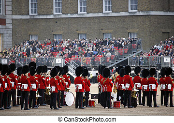 Massed Bands at Beating Retreat 2012. Beating Retreat is a military ceremony takes place on Horse Guard Parade in White Hall, London. This ceremony is performed by military band like bands of the Foot Guards and Household Cavalry.