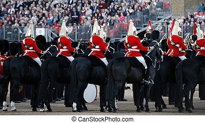 Mounted Bands at Beating Retreat 2012. Beating Retreat is a military ceremony takes place on Horse Guard Parade in White Hall, London. This ceremony is performed by military band like bands of the Foot Guards and Household Cavalry.