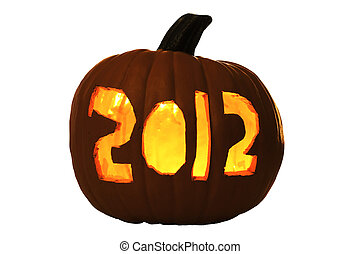 2012 Carved Halloween Pumpkin Lit by Candle inside, creating...