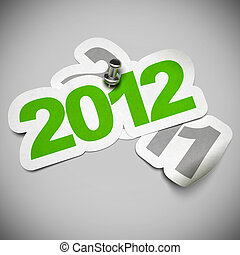 2012 green sticker fixed onto 2011 - 3d greeting card over a grey background, numbers are fixed with a metal thumbtack