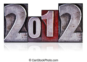 Photo of the number 2012 in old metal letterpress, isolated on a white background.