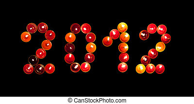 2012 made of colored candles on a black background