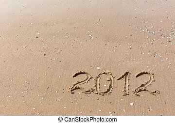 2012 Year written on the beach sand