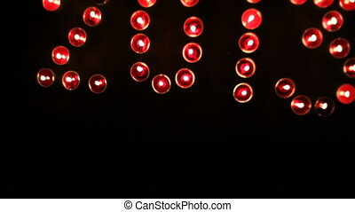 "2013 ""written"" by candles. Crane shot. Circle move"