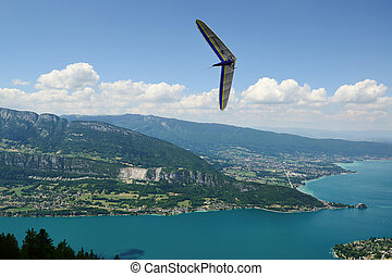 2014-06-25 Annecy; France. Hang glider pilot do extreme aerobatic maneuvers over lake Annecy.