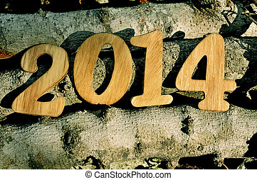 2014, as the new year, written with wooden numbers on a pile...