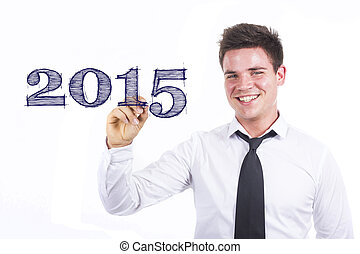 2015 - Young smiling businessman writing on transparent surface