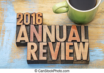 2016 annual review word abstract in letterpress wood type with a cup of coffee