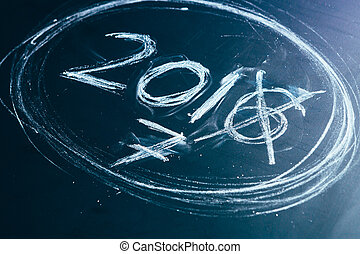 2016 crossed and new years 2017 on chalkboard