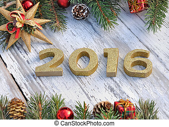2016 new year - golden figures 2016 on white table with ...