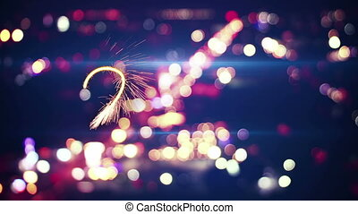 2016 new year sparkler text and city bokeh lights