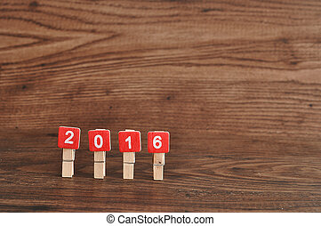 2016 on a wooden background