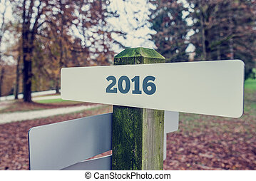 2016 sign on a wooden signboard