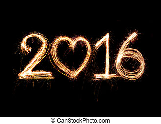 2016 word written with Sparkle firework on black background