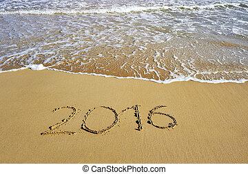 2016 written on sand beach - happy new year concept
