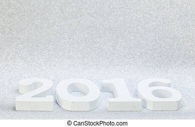 2016 year white wood number with sparkling wall background