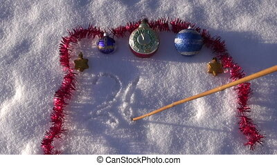 2016 year write on fresh snow and Christmas toys