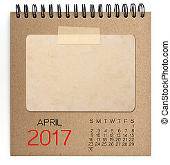 2017 calendar on brown notebook with old blank photo