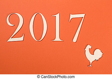 2017 on orange background. Year of cock.