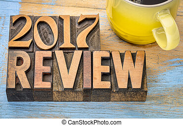 2017 year review banner - text in vintage letterpress wood type block with a cup of coffee