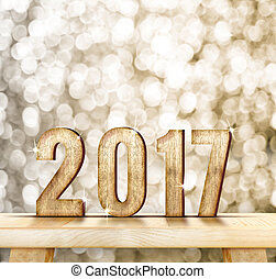 2017 year wood number on wood table with gold sparkling bokeh wall and wooden plank floor, leave space for adding your content