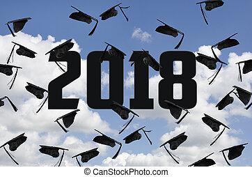 2018 black graduation caps in sky