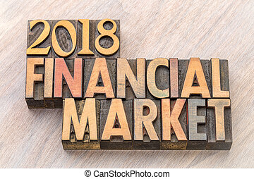 2018 financial market word abstract in wood type