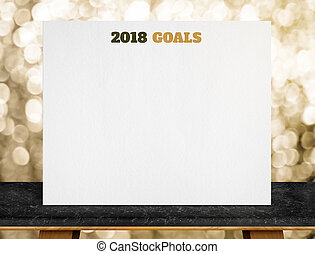 2018 goals on white paper poster on black marble table with...