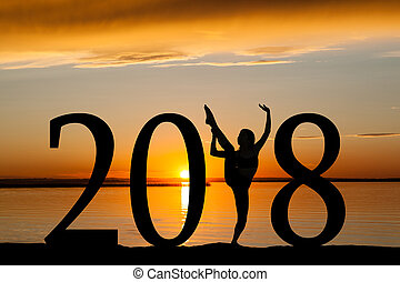 2018 New Year Silhouette of Girl Dancing at Golden Sunset