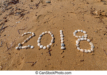 2018 New Year text on sand