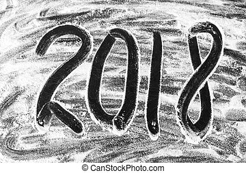 2018 New Year written in flour