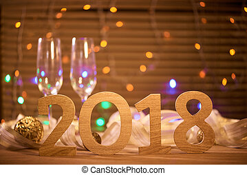 2018. New years eve celebration background with champagne