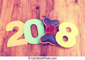 2018 word on wooden background, Year of the dog.
