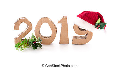 2019, handmade 3D numbers made of reused cardboard paper, with santa's red hat on nine, on white background.