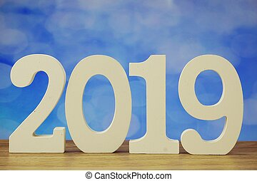 2019 happy new year with number letters on blue bokeh background
