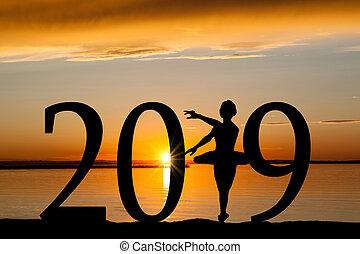 2019 New Year Silhouette of Ballet Girl at Golden Sunset