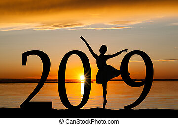 2019 New Year Silhouette of Ballet Girl at Golden Sunset