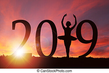 2019 New Year Silhouette of Girl Dancing at Golden Sunrise