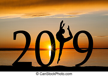 2019 New Year Silhouette of Girl Dancing at Golden Sunset