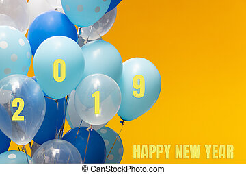 2019 New Year with colorful balloons on orange background.