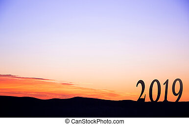 2019 On dark mountains, with vivid and beautiful sunrise as...