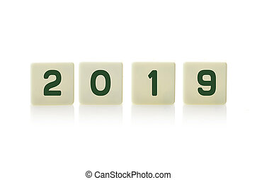 2019 on plastic tile pieces in a row, on a white background.