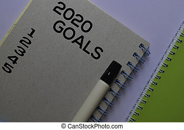 2020 Goals write on sticky notes. Isolated on white table background