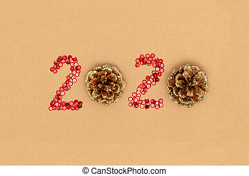 2020 made of sparkles and decorative pine cones on craft sheet of paper. Happy new year 2020 concept