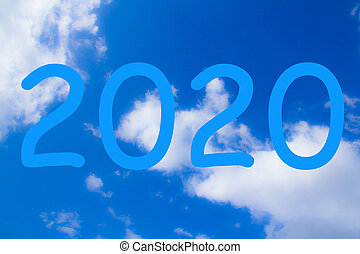 2020 new year symbol on a background of blue sky with clouds